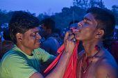 Tongue piercing in Gajan festival