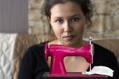 Girl With A Toy Sewing Machine