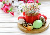 picture of icing  - Easter cake with glace icing and colored easter eggs rustic style - JPG