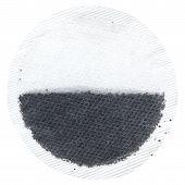 Single round tea bag on white background.