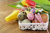 Easter still life with spring flowers tulips and eggs on a wooden background