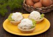 Tartlets With Cheese And Egg Balls On A Yellow Plate And Eggs In The Basket.