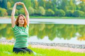 Girl Performs Stretching Exercises Back Muscles In Nature