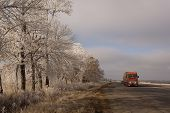 Red Heavy Vehicles On The Winter Road