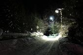 Lights illuminate the road in the village