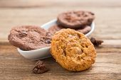 Plate Of Chocolate Chip Cookies On Wooden Table (selective Focus)