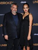 LOS ANGELES - DEC 15:  Luc Besson & Talia Besson arrives to the