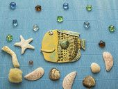 collage ceramic fish under water with shells