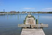 picture of pontoon boat  - wooden pontoon in Okracoke harbour Outer Banks - JPG