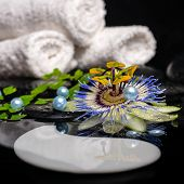 Spa Concept Of Passiflora Flower, Branches, Towels, Zen Basalt Stones, Symbol Yin Yang With Drops An