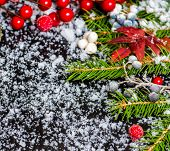 Winter Christmas Concept Of Evergreen Branches, Red Leaves And Berry With Snow, Closeup