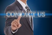 Businessman hand pushing contact us