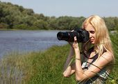 Girl photographer on the nature.