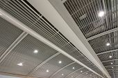 Beautiful geometric ceiling and the channel of building inside a station.