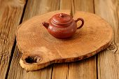 Small Yixing Red Clay Teapot On Wooden Board