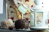 Christmas lamp with caramel apple and nuts and sock on background