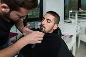 Hairdresser Shaving Man's Mustache