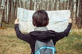 Woman looking at a map outdoor