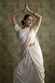 Young beautiful brunette woman in indian white dress