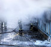 image of fireman  - Firemen working to extinguish fire in building - JPG