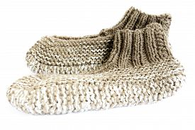 foto of budge  - Traditional Bulgarian knitted slippers isolated on white - JPG