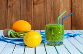 pic of light weight  - Healthy homemade kiwi juice in glass and fresh orange - JPG