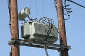 picture of transformer  - Old electric power transformer on a post - JPG