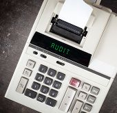 picture of financial audit  - Old calculator showing a text on display  - JPG