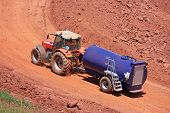 stock photo of bowser  - tractor pulling a water bowser on a construction site - JPG