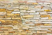 foto of untidiness  - untidy or uneven brick wall texture background - JPG