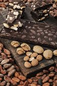 foto of cocoa beans  - Cocoa beans almonds and dark almond chocolate - JPG