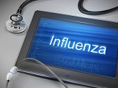 image of influenza  - influenza word displayed on tablet with stethoscope over table - JPG