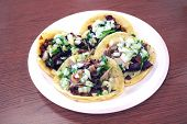 stock photo of tacos  - Carne Asada and Carnitas Taco Plate at Authentic Mexican Restaurant