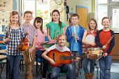 pic of orchestra  - Portrait Of Students Playing In School Orchestra Together - JPG
