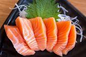 stock photo of exotic_food  - A dish of fresh salmon sashimi on ceramic plate  - JPG