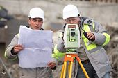 picture of inspection  - Civil Engineer and Surveyor at at construction site are inspecting ongoing production according to design drawings - JPG