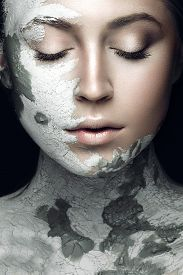 pic of face mask  - Beautiful girl with mud on his face - JPG