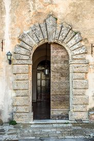 picture of entryway  - Entrance doors of an old church in Tuscany - JPG