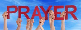stock photo of prayer  - Many Caucasian People And Hands Holding Red Straight Letters Or Characters Building The English Word Prayer On Blue Sky - JPG