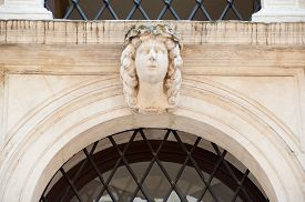 pic of vicenza  - White stone mascaron on the entrance door arch of a historical palace of Vicenza - JPG
