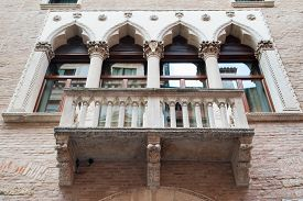 picture of vicenza  - View of a balcony and columns of Cavalloni Thiene Palace in the historical Contr - JPG