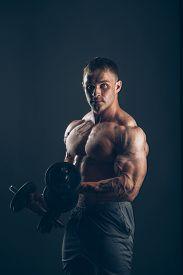 stock photo of bicep  - Muscle man doing bicep curls - JPG