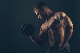 picture of bicep  - Muscle man doing bicep curls - JPG