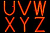 Red neon letters on a black background (UVWXYZ).