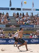 HUNTINGTON BEACH, CA. - MAY 23: Phil Dalhausser jump serves during the AVP Huntington Beach Open south of the pier on the weekend May 23, 2009 in Huntington Beach, California