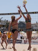 MANHATTAN BEACH, CA. - JULY 18: Chelsea Hayes spiking the ball and Jenny Kropp attempting to block at the AVP Manhattan Beach Open on July 18th 2009.