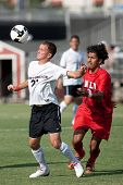 NORTHRIDGE, CA. - AUGUST 28: Devin Deldo (L) chest traps the ball in front of Mike Mota (R) during the UNLV vs. CSUN pre-season exhibition on August 28, 2009 in Northridge, Ca.