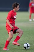 NORTHRIDGE, CA. - AUGUST 28: Stephan Sifuentes dribbling up field during the UNLV vs. CSUN pre-seaso