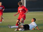 NORTHRIDGE, CA. - AUGUST 28: Luis Gil (R) slide tackles Trey Jasenski (L) during the UNLV vs. CSUN p