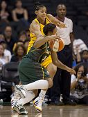 LOS ANGELES, CA. - SEPTEMBER 16: Candace Parker (in yellow) defending against Tanisha Wright (in gre
